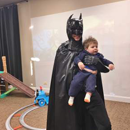 Batman holding a baby