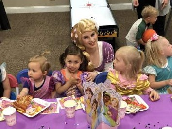 Rapunzel sitting at a table